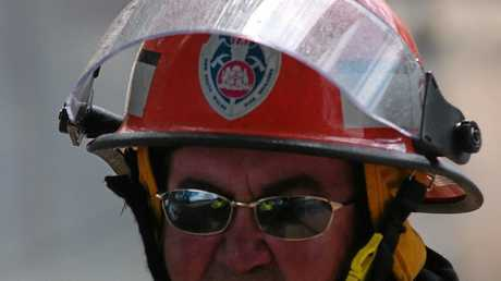 A soot-blackened Col Barnard at the scene of the biggest fire in Maclean's history