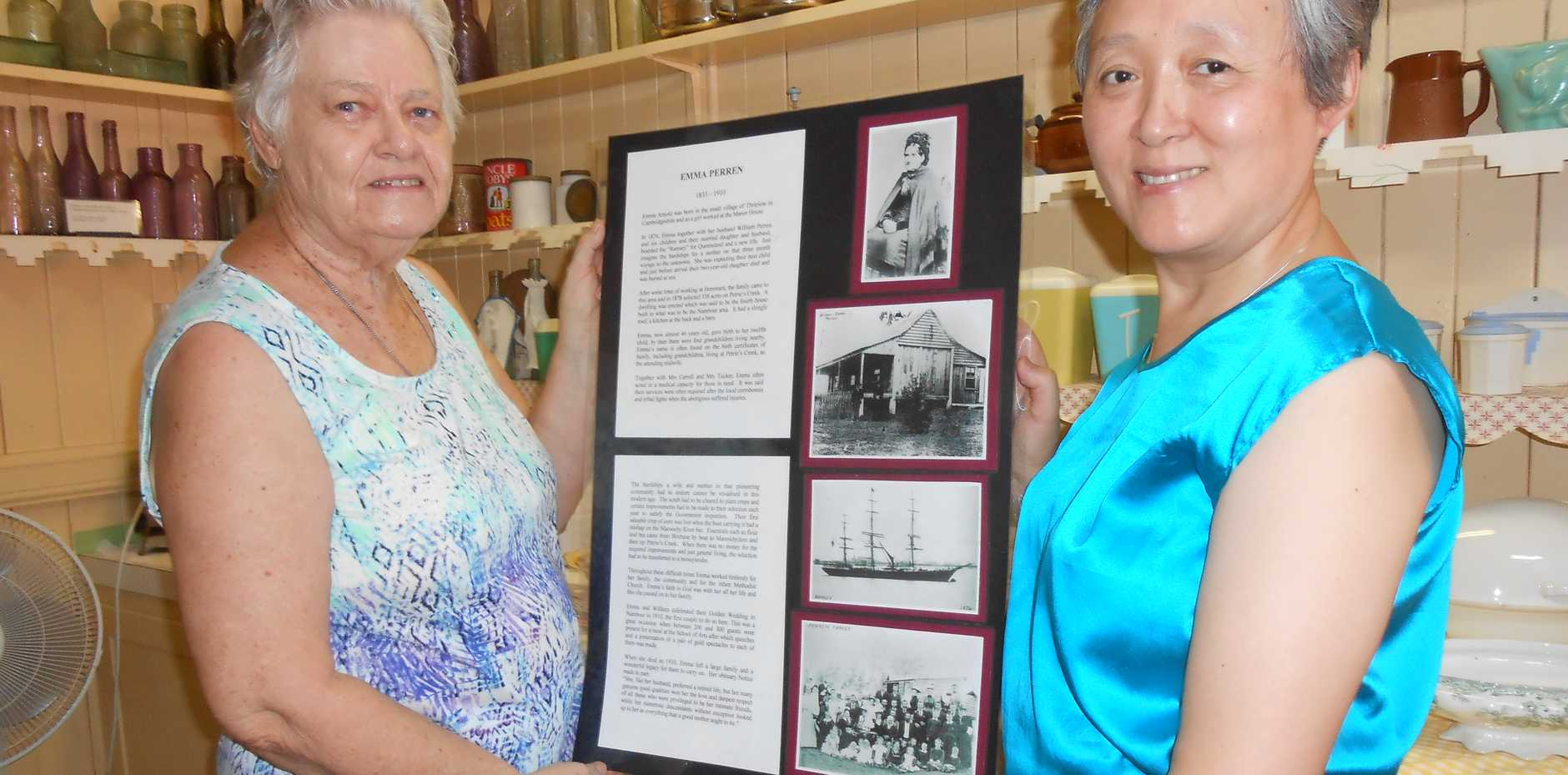 Museum volunteers Dawn Percival and Kathy Wang with the story of  Emma Perren.