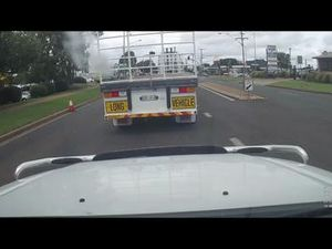 Small car undertakes huge truck