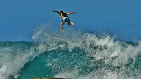 Ian Ward captured this amazing image of a surfer bailing a big wave at Pt Cartwright on the Sunshine Coast.