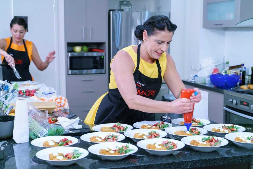 My Kitchen Rules contestants Lisa and Hazel prepare their entree during their instant restaurant.