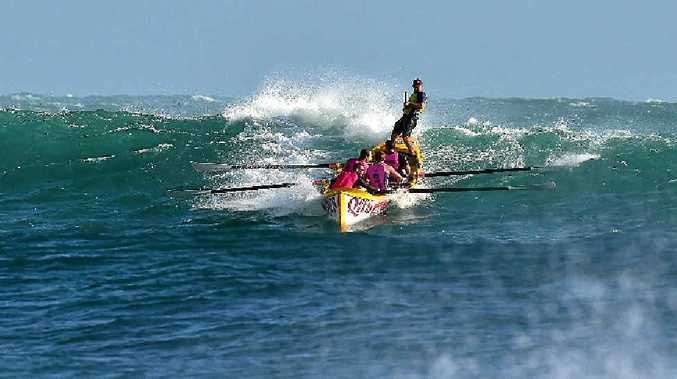 LONE BOAT: The Alexandra Headland open men's surf boat crew takes on the big swells off Mooloolaba.
