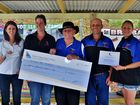 Brisbane Convoy for Kids cheque presentation. Riding for the Disabled Qld Treasurer Lenore Schumacher and State coach coordinator Rhiannon Hutchings with Brisbane Convoy for Kids patron John Moran, President Craig O'Brien and Secretary Leanne Dinning. Photo Contributed