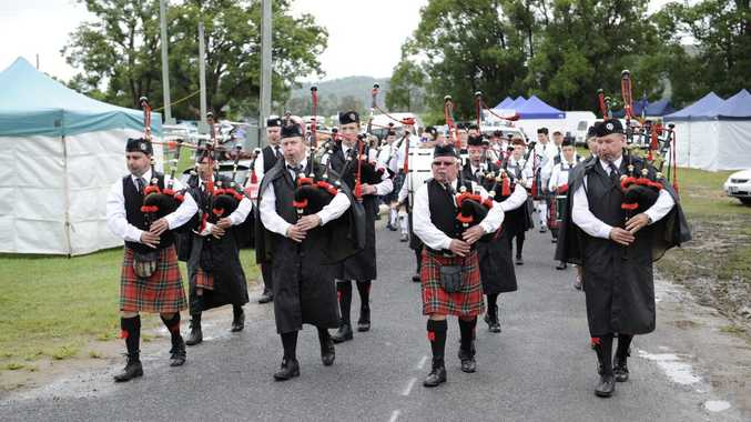 Maclean Pipe Band head back to home base after performing in the massed bands display at the 111th Maclean Highland Gathering at the Maclean Showground on Saturday, 4th April 2015. Photo Debrah Novak / The Daily Examiner