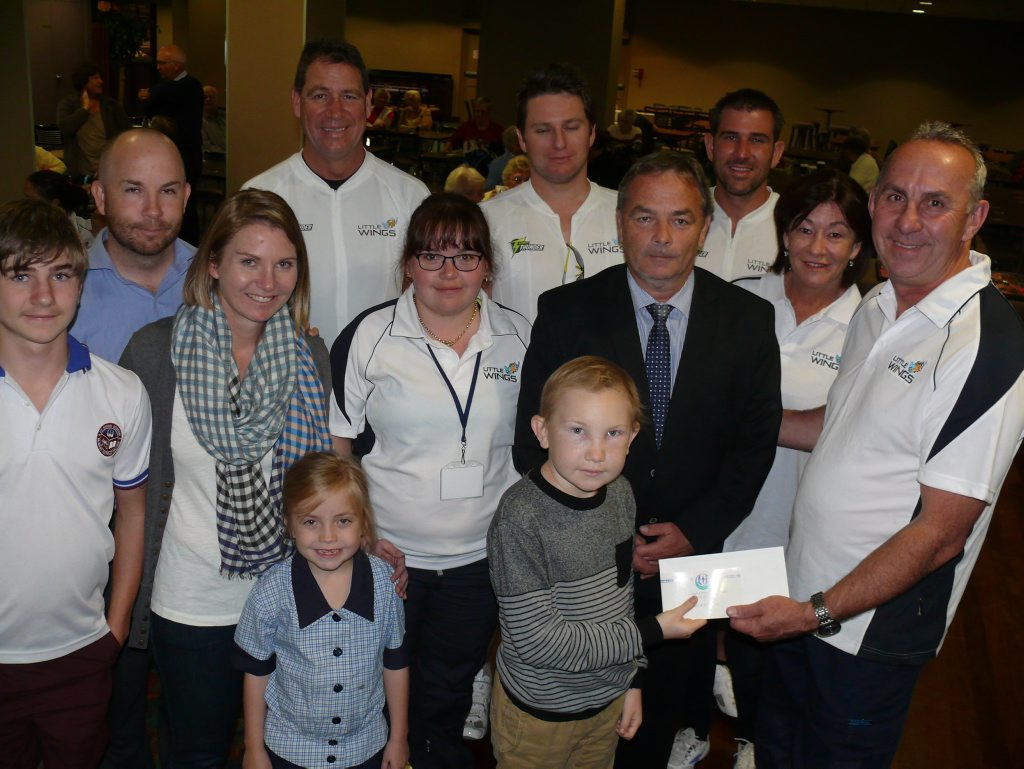 Front row - Sam Carroll presents a cheque for $400 to Little Wings boss Kevin Robinson. Looking on: Middle row, from left: Hugh Carroll, Angela Carroll, Alecia Treloar, St Joseph's principal Frank Jones, Little Wings media person Caroline Norman. Back row from left: Adam Carroll, Craig Madsen, Elijah Treloar and Aaron Fitzgerald. Photo Tim Howard / Daily Examiner