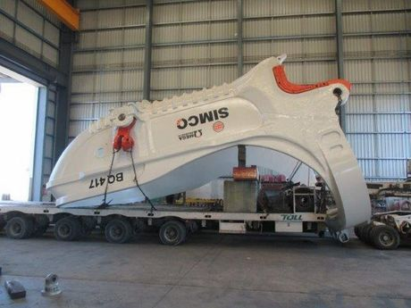 The giant dragline bucket loaded onto the truck prior to being taken from the workshop to Blackwater.