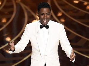 Chris Rock takes on Oscars race row in opening monologue