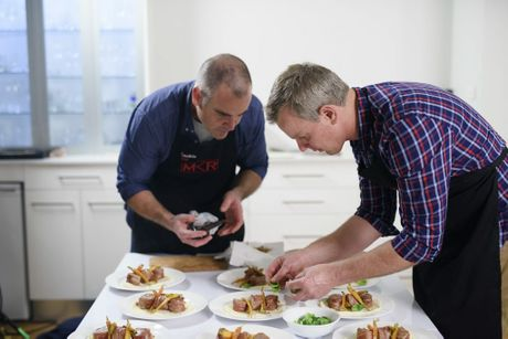 My Kitchen Rules contestants Chris and Cookie prepare to serve their main course during their instant restaurant in Newcastle.