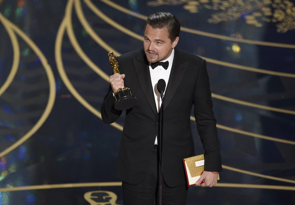 Leonardo DiCaprio accepts the award for best actor in a leading role for The Revenant at the Oscars at the Dolby Theatre in Los Angeles.