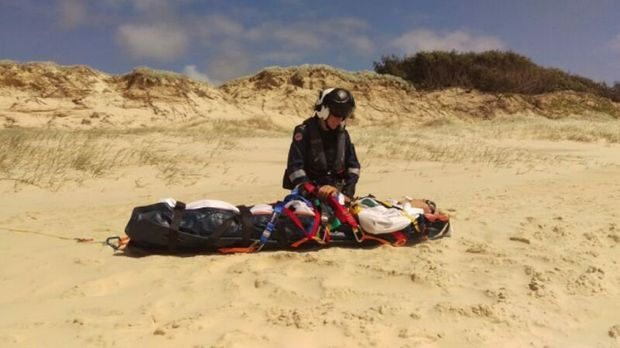 An Ipswich man was winched to safety after he crashed his motorbike on Fraser Island.