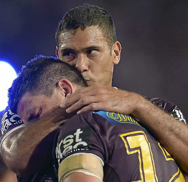 SAD DAY: Justin Hodges consoles Matt Gillett after the grand final defeat to Cowboys.