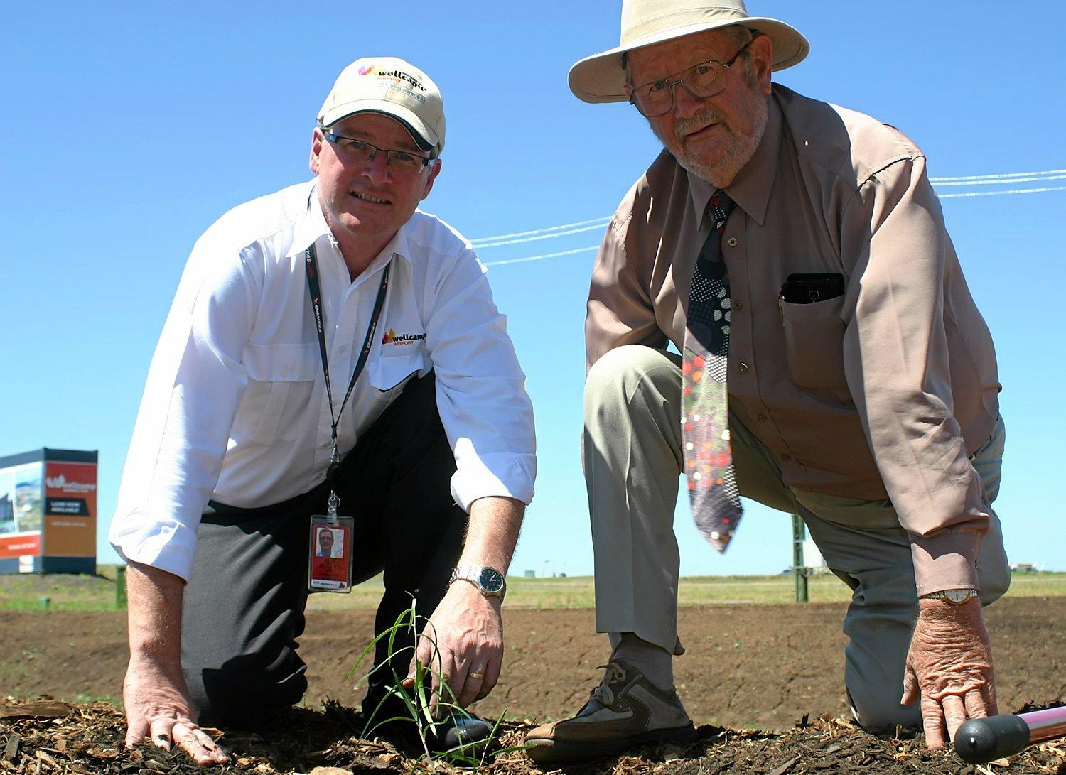 GO GREEN: Wellcamp Airport general manager Phil Gregory and QMDC Chair Noel Strohfeld plant a tree on Friday.