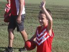 Cooper Pearson waving at his teammates during a training session.