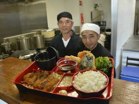 Tim Hsieh (right) his father Hsueh Tao Hsieh serve up a plate of their finest cuisine. Photo Contributed