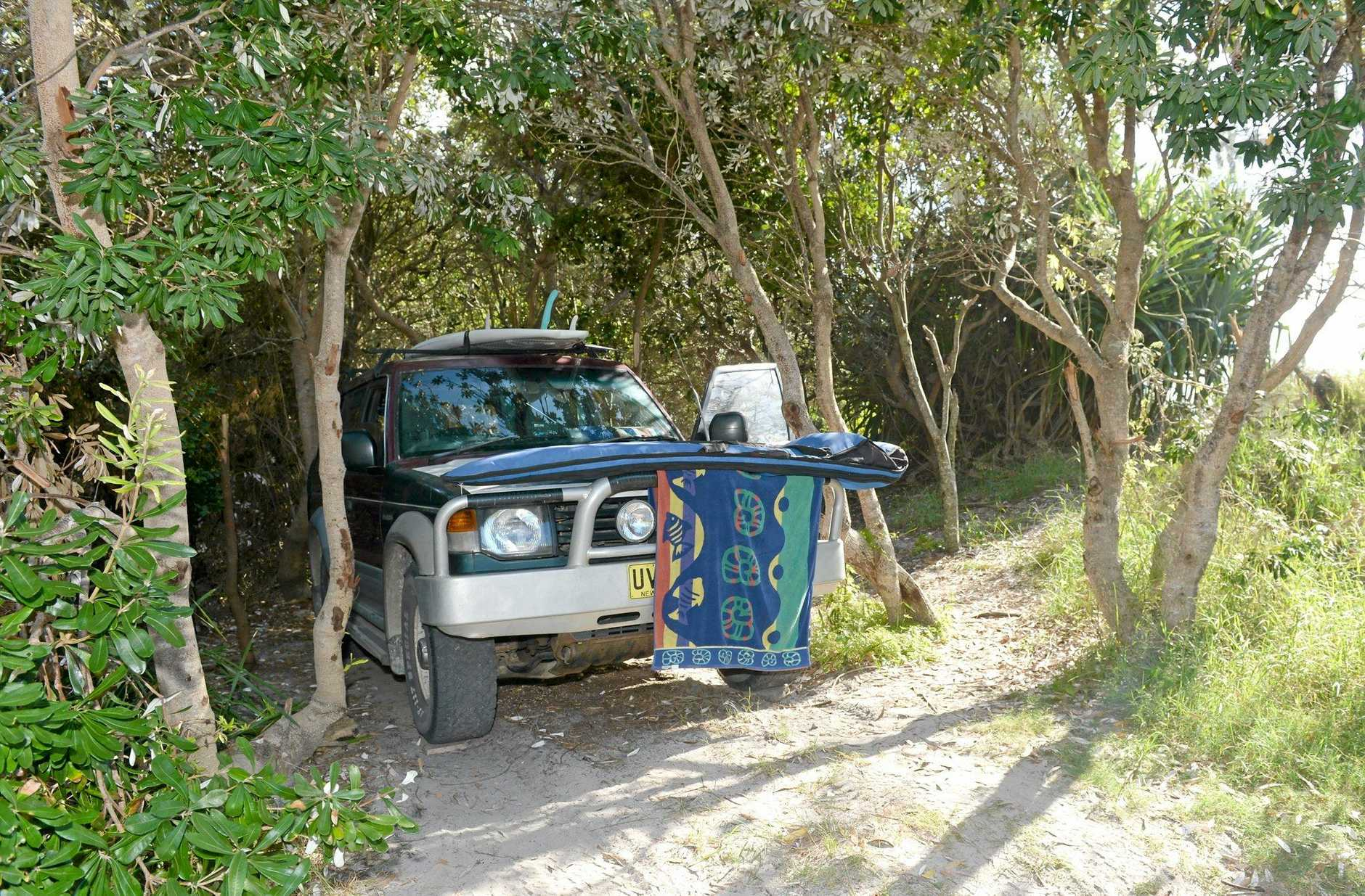 A local says this man has been camping illegally at Black Rocks for six months.