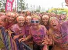 PHOTO COLOUR BOMB: A very messy smile for the camera after the finish line of the Colour Me Rad run at Yamba.