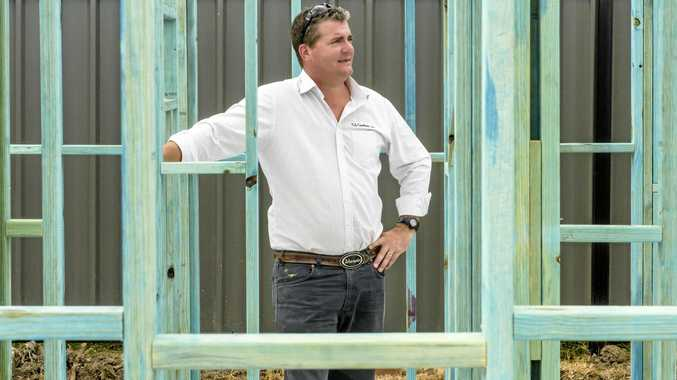 HAMMERING AHEAD: Managing director of GJ Gardner Homes Grafton, Micah Middelbosch, stands in the frames of a house they are building in Junction Hill.