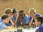 Students check out mates at chess tournament