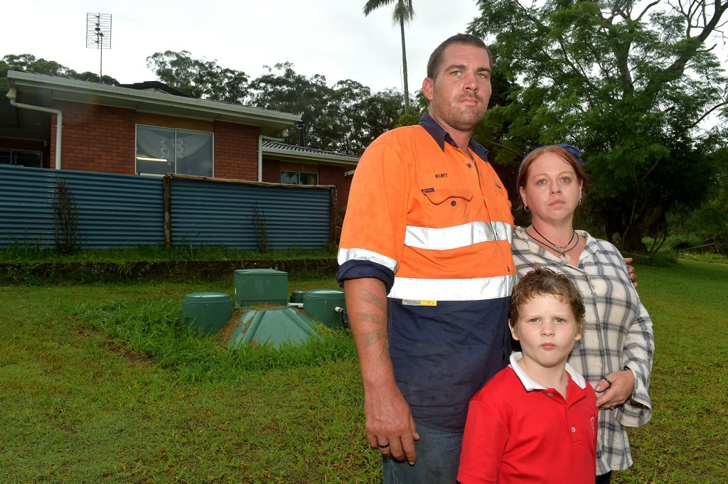 Kurt Semple has been told to vacate his rentall home because of the flying foxes in the area. Kurt is pictured with his wife Tiana and son Dylan.