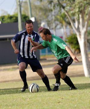 Emerald Eagles' Matt Kirby jostles for the ball. Photo Kelly Butterworth / CQ News