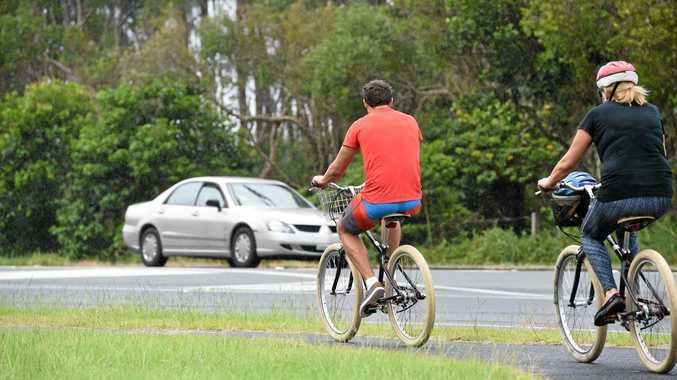 SPOTTED: Cyclists riding in Byron Bay without helmets (except for the woman pictured above right).