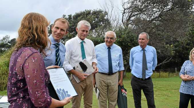 Tweed Shire Council Mayor Katie Milne officially receives a grant from NSW Planning Minister Rob Stokes at Cabarita Headland today.