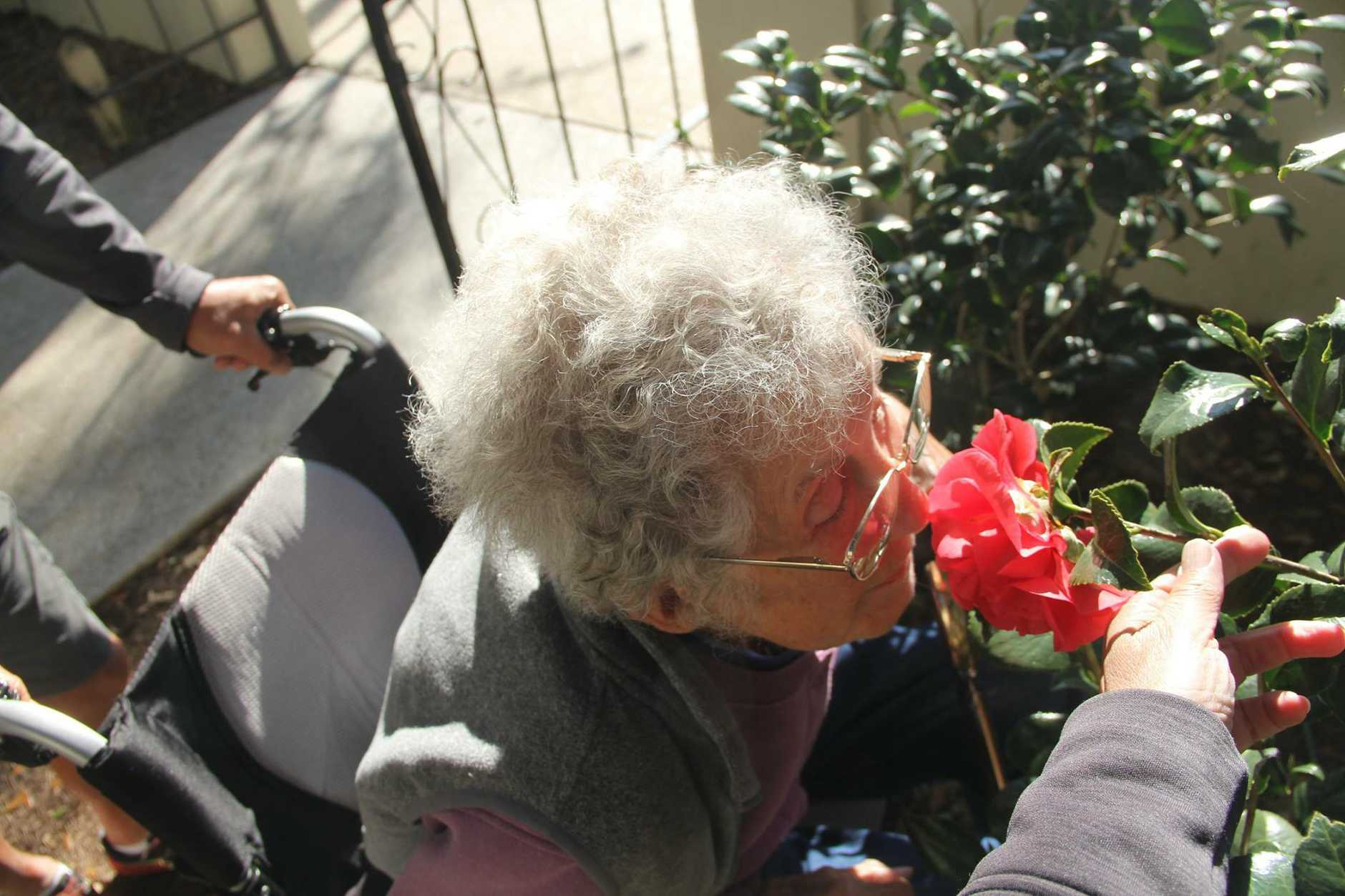 Norma taking time to smell the flowers.