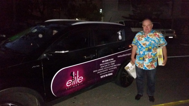 Robert Green with the car Elite Strippers are advertising on the side of which is used for Uber. Photo: Supplied
