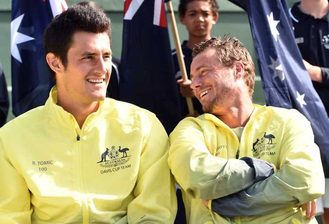 Lleyton Hewitt (right) shares a joke with Bernard Tomic yesterday. Photo: AAP Image