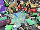 Hervey Bay Library - Brick by Brick: Build Your Own Capital Exhibition. Howard State School students work on their Canberra Lego creations.