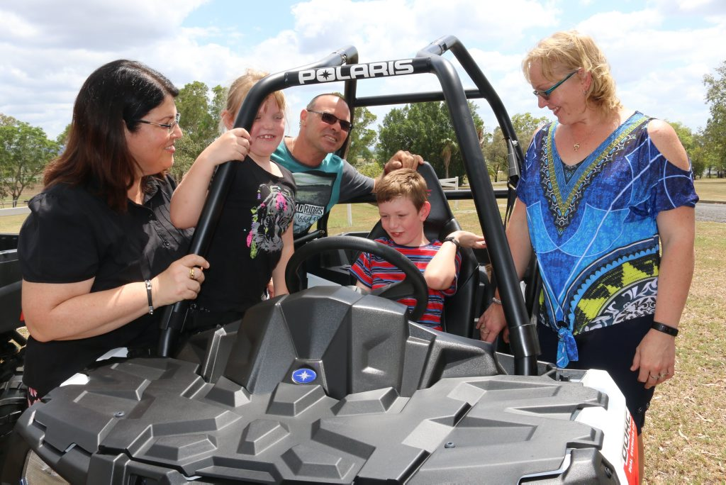 QUAD SAFETY: Minister for Industrial Relations Grace Grace launched the 'State-wide Plan for Improving Quad Bike Safety in Queensland' at UQ's Gatton campus on Thursday. Pictured is minister Grace with the Cocco family from the Atherton Tablelands (from left) Olivia, Mario, Domenic and Jodie.Photo Tom Threadingham / Gatton Star