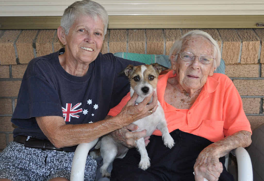 TINY TERROR: Lyn Solburn (left) with mum Joyce Elliott and Molly the brave little Jack Russell terrier.