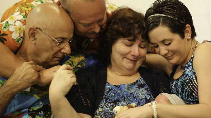 GOODBYE: Baby Wesley's parents Craig and Aimee Carson, and grandparents Charles and Chris Portelli.
