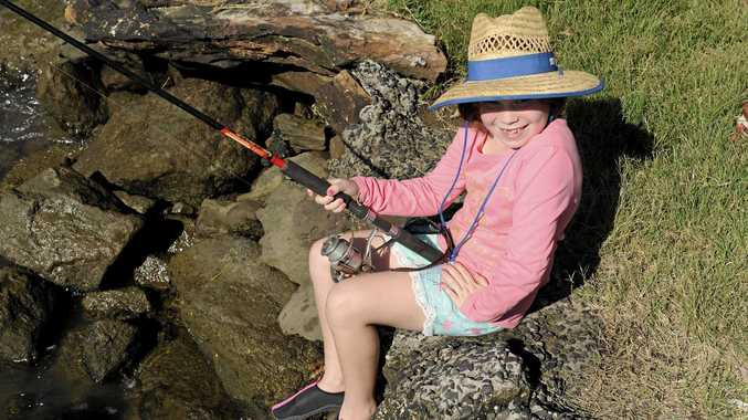 HAPPY DAYS: Abbie Leornard of Ipswich was fishing on the banks of the Clarence River at Maclean.