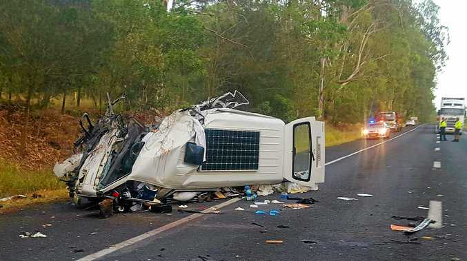 EXTENSIVE DAMAGE: Emergency services attend the scene of a head-on collision between a van and semi-trailer on the Pacific Highway near Glenugie.
