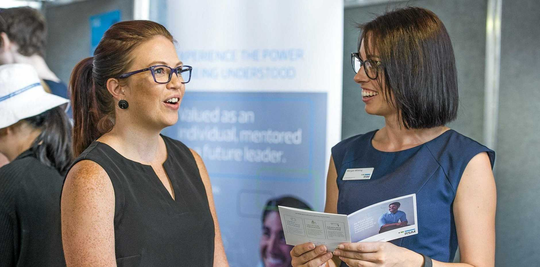 STUDY TIME: USQ postgraduate student Rachel Butler (Master of Business Administration) speaks to industry representative and USQ graduate Morgan Whiting (senior accountant at RSM Australia) at the USQ Career Fair.