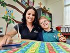 HONOURED: St James Lutheran College's award winning learning support teacher aide Stephanie Conroy with 11-year-old Ethan Parry.