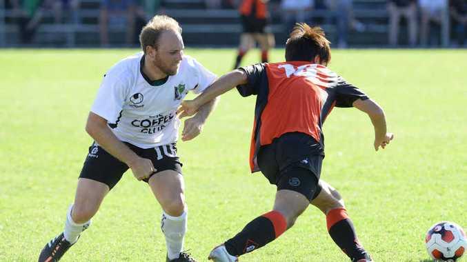 KEEN EYE: Ipswich Knights goal scorer Lucas Wilson (left) challenges an Albany Creek player during the Brisbane Premier League season opener at Bundamba.