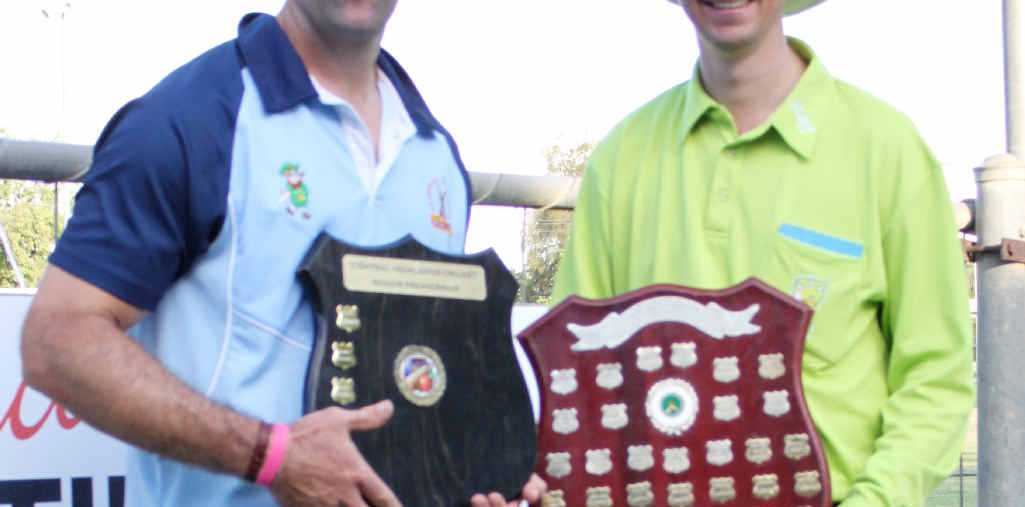 TROPHY: Chris O'Shea with umpire Damian Freiberg and the coveted trophy.