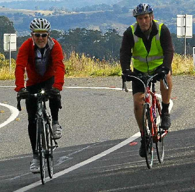 Former Aspley High School mates Randal Bishop and Mark Driver ascend Ben Lomond in the New England Tablelands on their way to Sydney in last year's Bridge to Bridge Cycle Charity Ride. Photo: contributed.