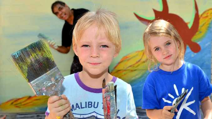 BUDDING ARTISTS: Johnathon Mason, 4, and Sari Smith, 3, at C&K; Cotton Tree Community Child Care Centre with Arthur Conlon painting a mural.