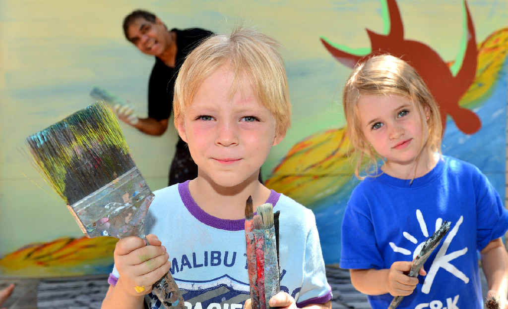 BUDDING ARTISTS: Johnathon Mason, 4, and Sari Smith, 3, at C&K; Cotton Tree Community Child Care Centre with Arthur Conlon painting a mural.