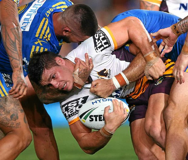 CENTRE OF ATTENTION: James Roberts is caught this time during the NRL season-opener at Pirtek Stadium on Thursday.