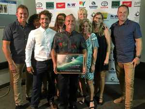Coffs Harbour Boardriders Club representatives receive the Simon Anderson Award from Surfing Australia as club of the year.