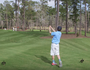 Tiger Woods watches kid hit hole in one