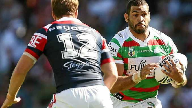 COMING THROUGH: Souths skipper Greg Inglis takes on the Roosters' defence.