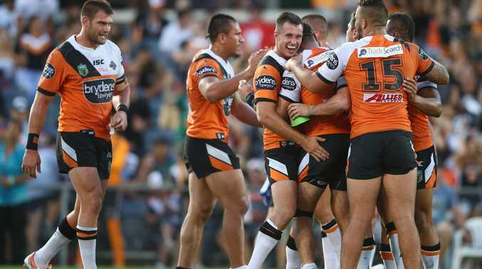 James Tedesco celebrates with Tigers teammates after the video referee gave his try the all clear. Photo: Getty Images.