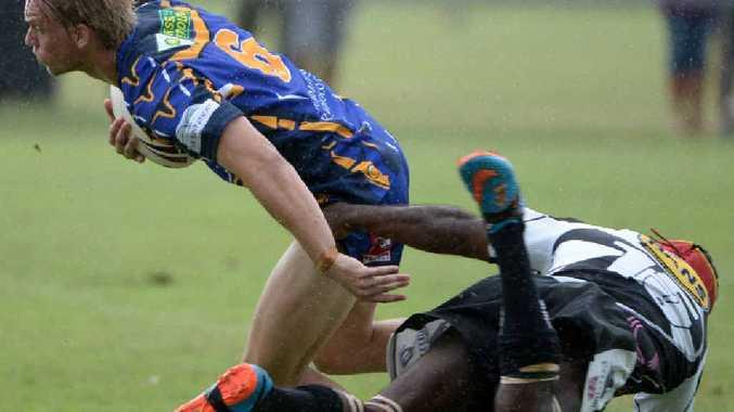 FELINE FINE: Waves Tigers player Zakarey Bainbridge shakes off Easts' Andrew Mason.