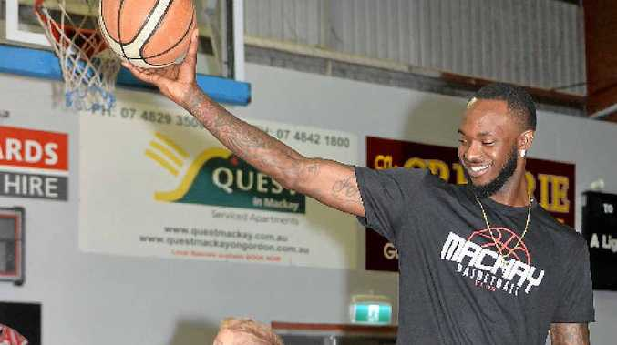 GOOD PICKUP: Nick Wiggins will play for the Mackay Meteors this season. He's already fitting in with the club as he plays with Logan Rebetzke, 7, the son of Wade Rebetzke, who is Mackay Basketball's business development manager.