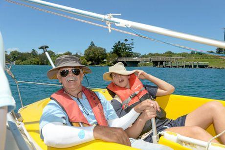Matthew Grant, of Banora Point High School, enjoys sailing with Ken Alchin.